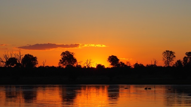 Sonnenuntergang im Okavango Delta/Botswana, Foto Sabine Lueder